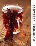 jerky beef with beer   homemade ...   Shutterstock . vector #338812538