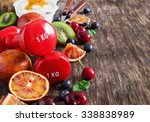 red dumbbells and various ripe... | Shutterstock . vector #338838989