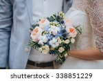 the groom and the bride dressed ... | Shutterstock . vector #338851229