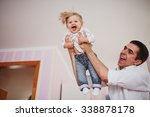 beautiful family of three... | Shutterstock . vector #338878178
