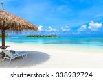 tropical beach in maldives with ... | Shutterstock . vector #338932724