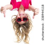 a little girl with upside down...   Shutterstock . vector #338944118