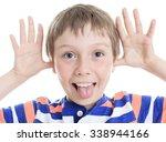 A Little Boy Wincing On White...