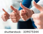 hands close up. group young... | Shutterstock . vector #339075344