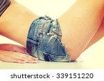 slim woman body in jeans shorts. | Shutterstock . vector #339151220