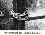 Rusty Chain On Gate On Black...