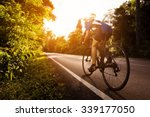 female cyclist cycling am the... | Shutterstock . vector #339177050