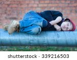 young homeless boy sleeping on... | Shutterstock . vector #339216503