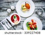 Постер, плакат: Three plates with lunch