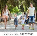Family Of Four Walking With...