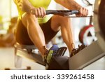 Stock photo fit man training on row machine in gym 339261458