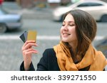 girl stands on a city street...   Shutterstock . vector #339271550