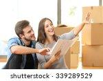 happy couple planning... | Shutterstock . vector #339289529