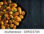 roasted potato in a frying pan | Shutterstock . vector #339321734