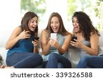 three friends amazed watching a ... | Shutterstock . vector #339326588
