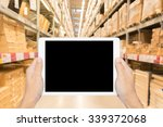 hand holding tablet on blurred... | Shutterstock . vector #339372068