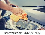 A Man Cleaning Car With...
