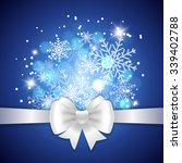 white ribbon and bow on blue... | Shutterstock .eps vector #339402788