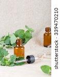 a dropper bottle of melissa... | Shutterstock . vector #339470210