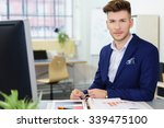 young businessman sitting at... | Shutterstock . vector #339475100