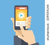 video app on smartphone screen. ...