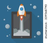 rocket launching from tablet.... | Shutterstock .eps vector #339568790