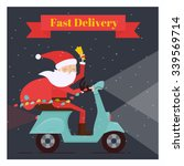 santa claus driving scooter.... | Shutterstock .eps vector #339569714
