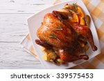 baked whole chicken with... | Shutterstock . vector #339575453