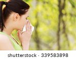 Small photo of Attractive woman outdoor with tissue having allergy.