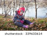 little girl sitting in the... | Shutterstock . vector #339633614