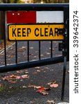 Small photo of 'Emergency Access Keep Clear' Sign gated street close up Jowett Walk Oxford, England.
