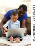 father and son on sofa in the... | Shutterstock . vector #339651956