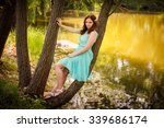 beauty girl outdoors enjoying... | Shutterstock . vector #339686174