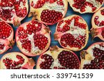 cut in half pomegranate on a... | Shutterstock . vector #339741539