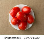 ripe roma tomatoes on a white... | Shutterstock . vector #339791630
