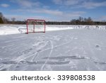 A Lone Red Hockey Net Sits On...