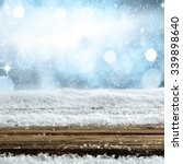 wooden desk and snow  | Shutterstock . vector #339898640