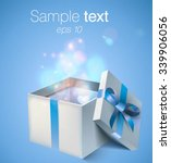 opened gift box with blue bow... | Shutterstock .eps vector #339906056