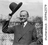Small photo of President Calvin Coolidge waves a hat presented to him by Smoki People of Prescott, Arizona. Ca. Sept-Oct. 1924