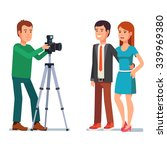 photographer takes a photo of a ... | Shutterstock .eps vector #339969380