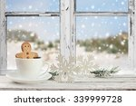 coffee cup on a snowy day... | Shutterstock . vector #339999728
