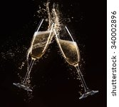 glasses of champagne with... | Shutterstock . vector #340002896