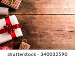 christmas presents laid on a... | Shutterstock . vector #340032590