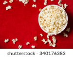 Bowl With Popcorn On Red...