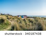 Beach Huts And Sand Dunes At...