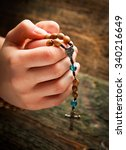 Young Hands With Wooden Rosary