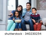 happy young family eating... | Shutterstock . vector #340230254