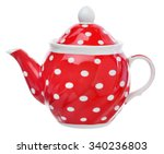 red teapot with white polka...