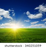 green field blue sky and sun.  | Shutterstock . vector #340251059