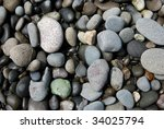 stones on a pebble beach | Shutterstock . vector #34025794
